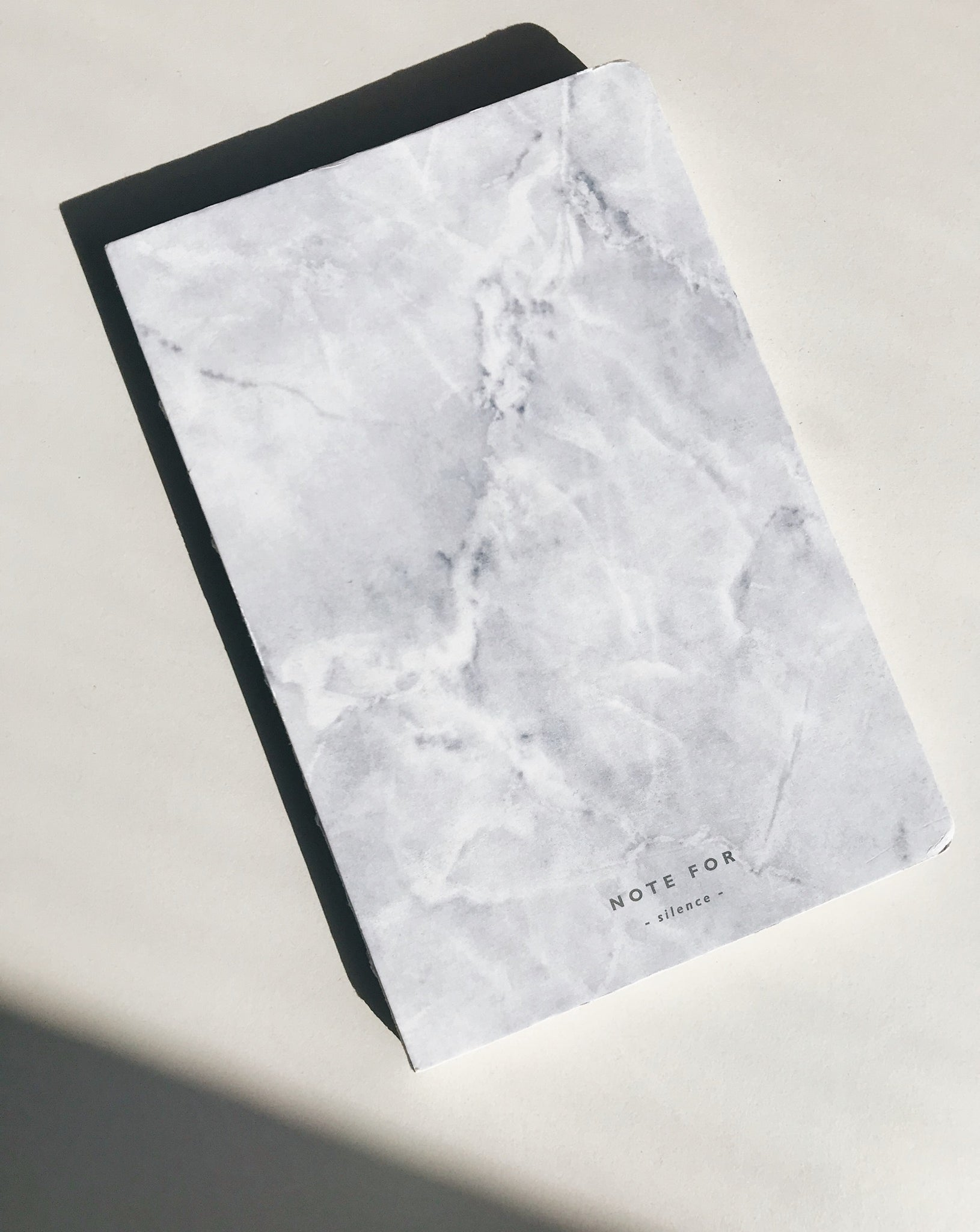 Beautiful, marble printed, white notebook with a hard-cover.