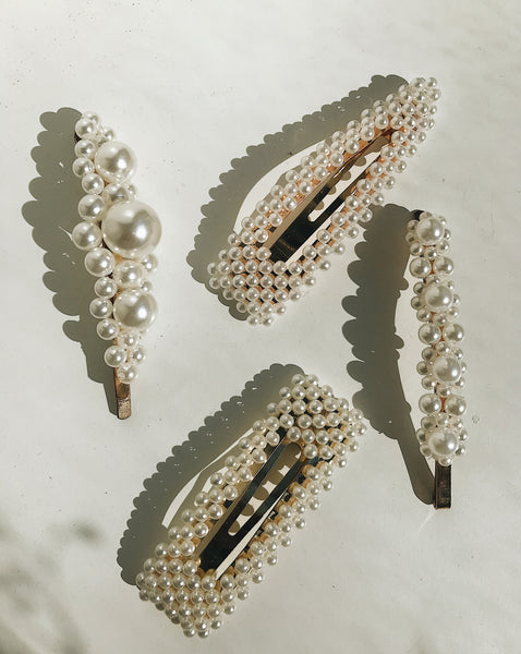 Mabe-Tri Pearl Hair Clip. Miniature (faux) pearls on a gold-colored alloy base in a triangle shape. Perfect to mix and match with other hair clips. Create your own hairstyle with this delicate accessory.