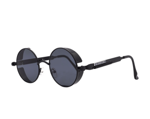 Migos Men Black Round Sunglasses. Round detailed black sunglasses with black rim detail and spiral spring on the sides.