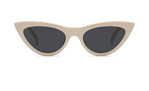 Beige Retro Cat Eye Sunglasses. Cat-Eye shaped sunglasses with a beige frame.