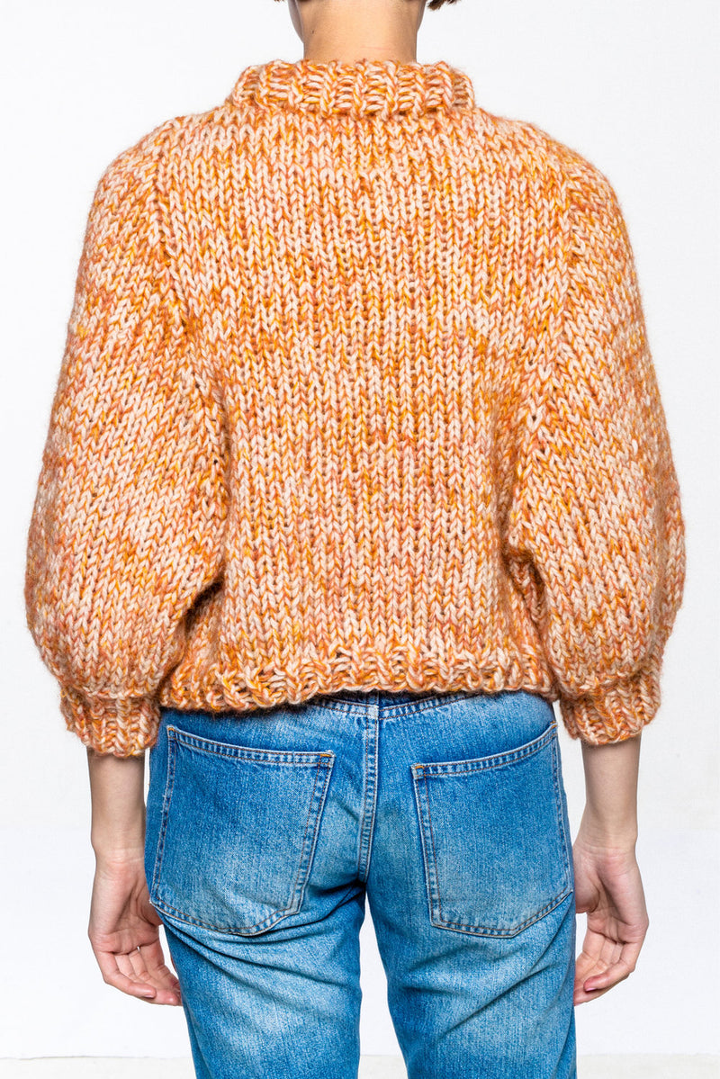 Hand knitted sweater in wool and mohair. 3/4 arm. Loose fit.