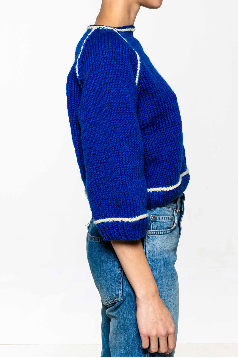 Hand knitted sweater in 100% wool. 3/4 arm. Contrast stripes