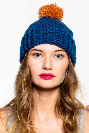 Hand knitted hat in 100% wool with pom pom