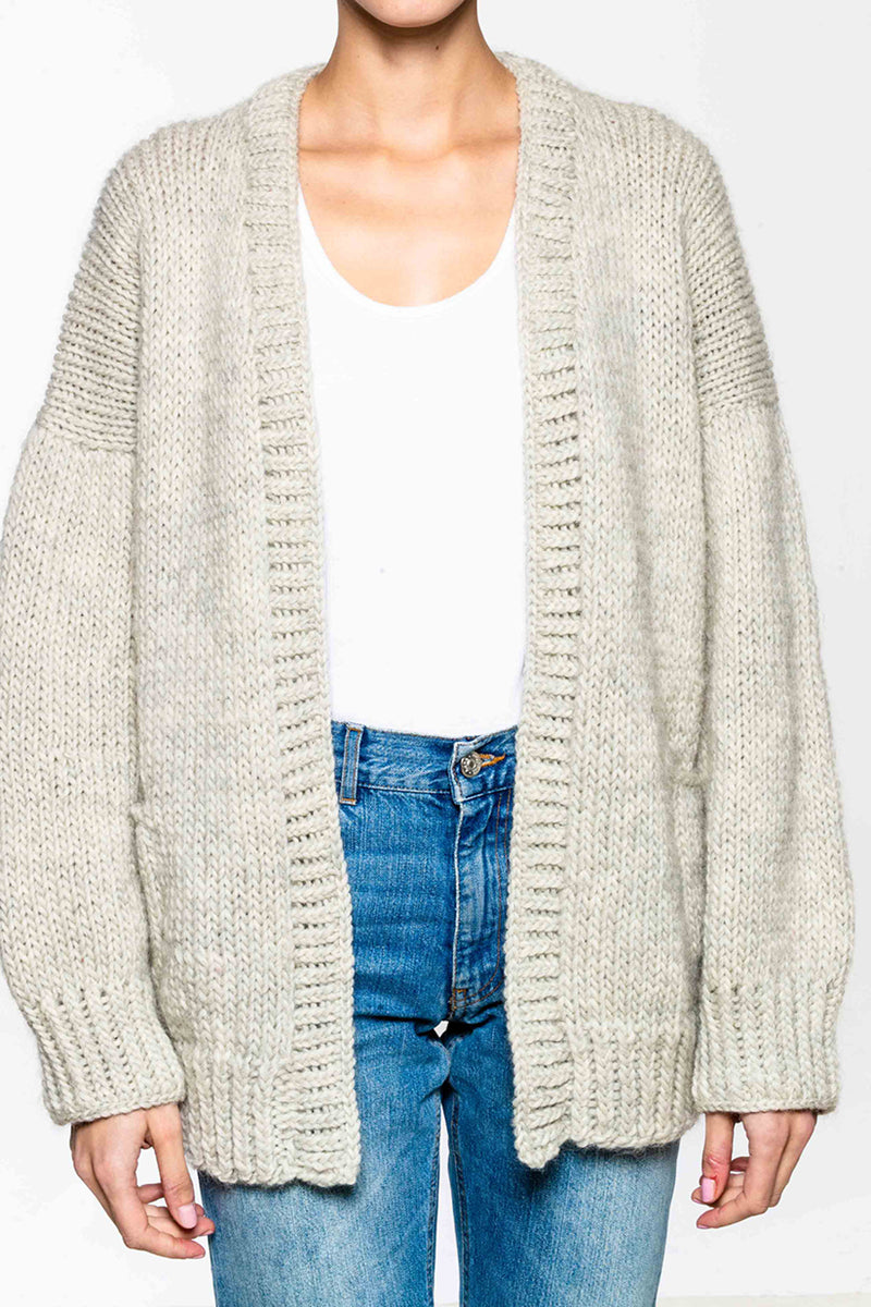 Hand knitted cardigan in 100% wool. Loose fit