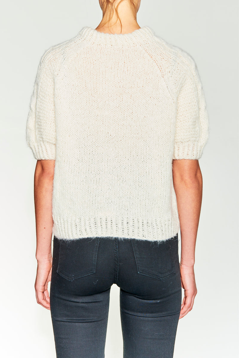 Hand knitted sweater, cable knit. 3/4 arm. Brushed alpaca. Loose fit.