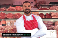Picture of Butcher in front of shop front