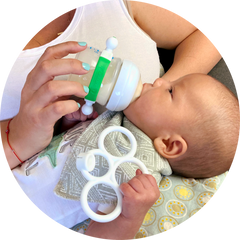 Baby using Bottle Grabbie with Grabbie Detached