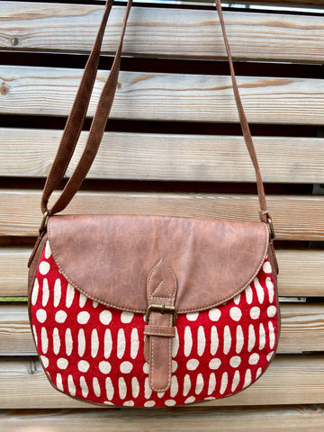 flap crossbody handbag in line & dot pattern