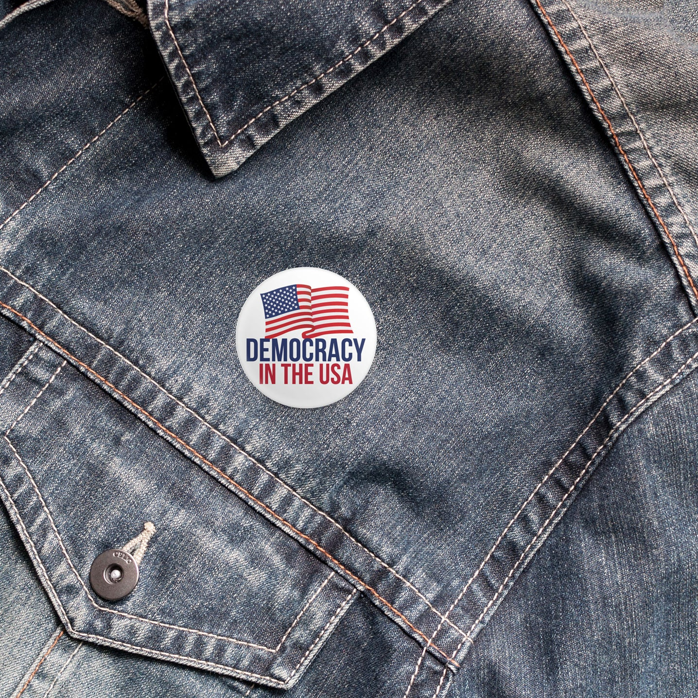 democracy in the usa button on denim jacket