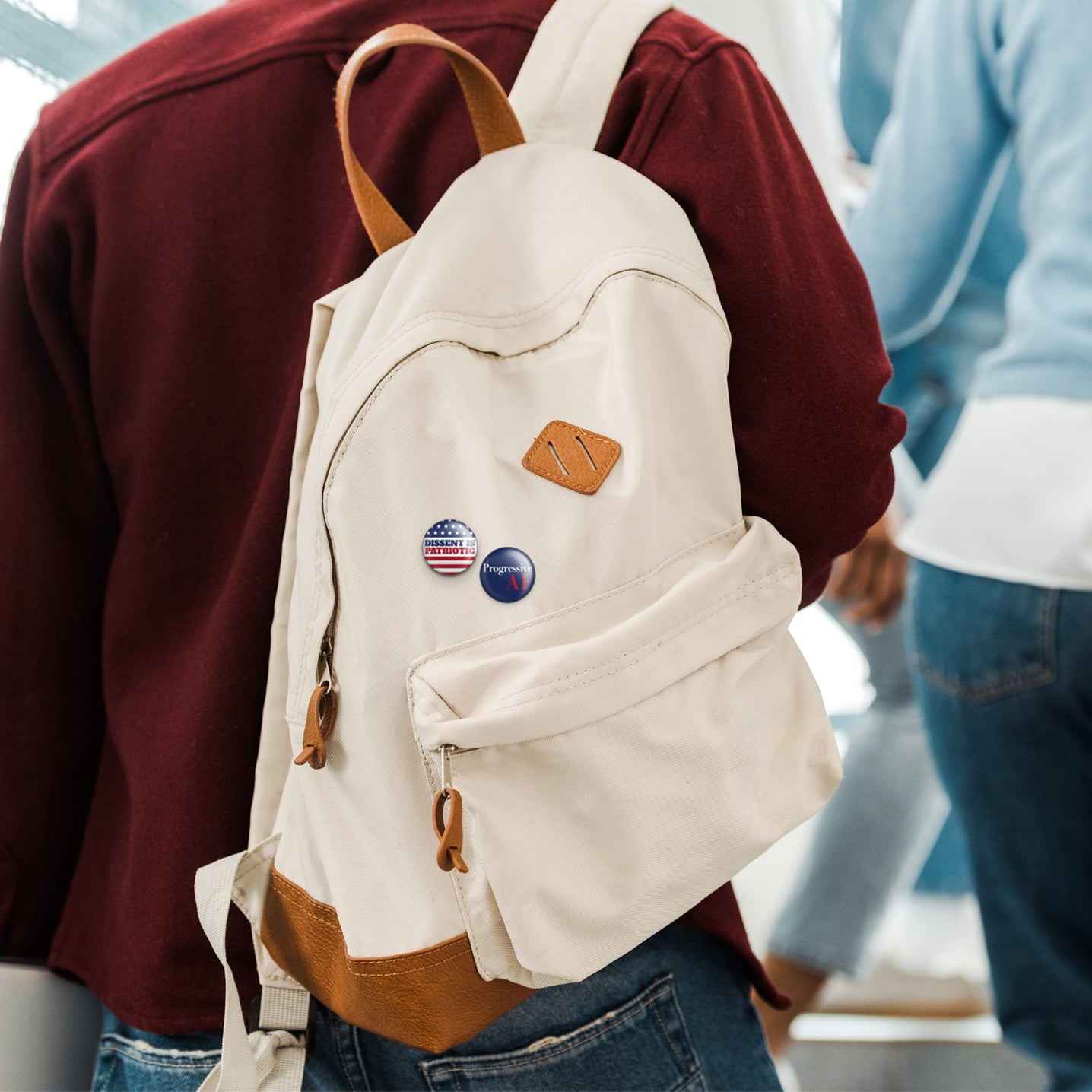dissent is patriotic buttons on knapsack