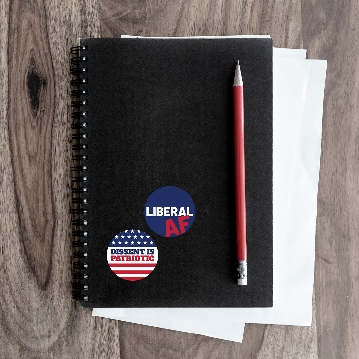 dissent and liberal stickers on a notebook