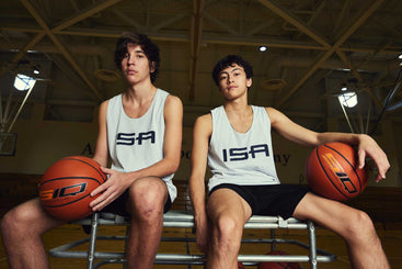Two male basketball players with the SIQ smart basketballs