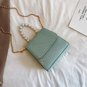 croc effect mini handbag with a pearl handle