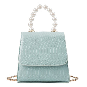 mini bag with a pearl top handle