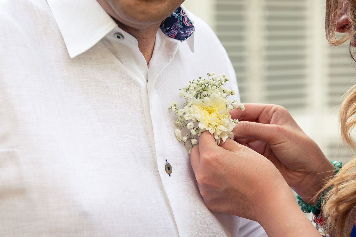 Happy groom with a linen white guayabera on his wedding day