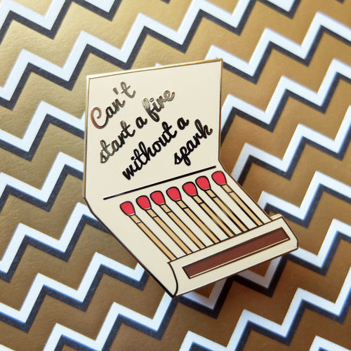 Can't start a fire without a spark. Hard enamel match book pin.