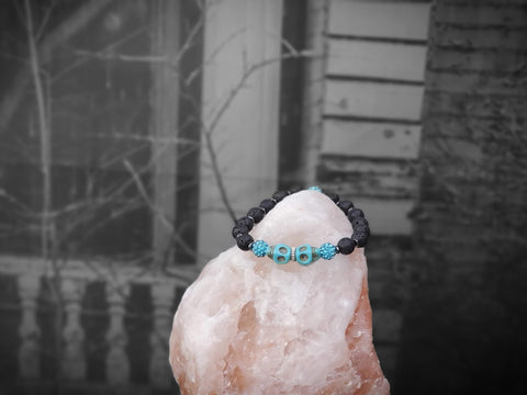 Aqua Skulls with Aqua Sparkles on Lava Stone Bracelet