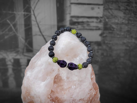 Purple Skulls with Green Sparkle Lava Bead Bracelet