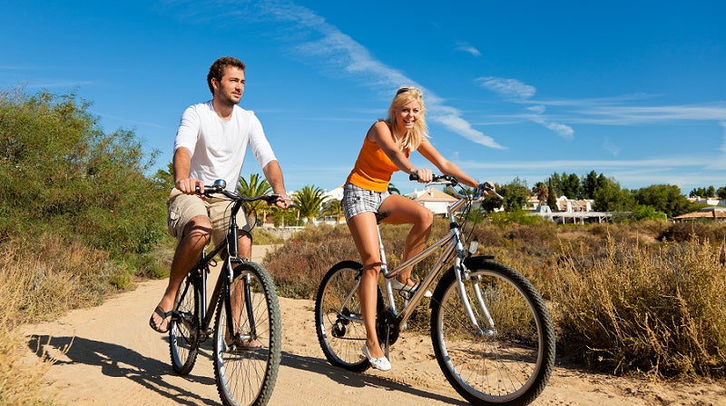 A hybrid bike is well suited for city rides and dirt roads.