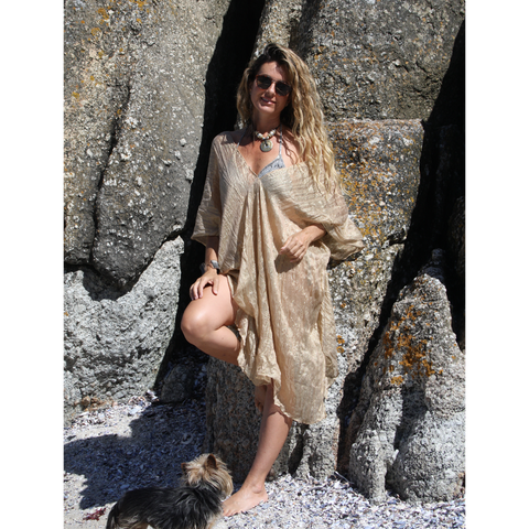 Shimmery gold summer kaftan on the beach