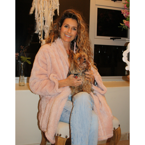 Dusty pink warm, fluffy winter jacket at home