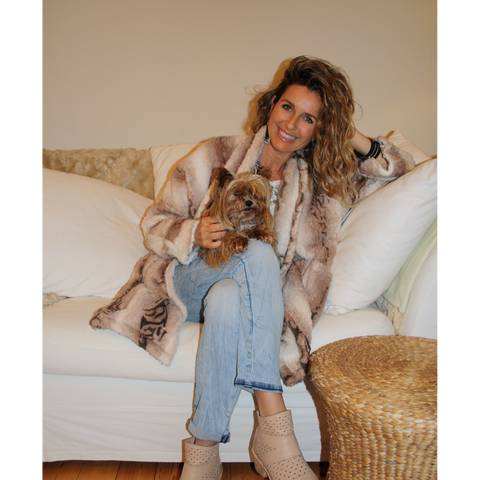 Neutral animal print warm, fluffy winter jacket on the couch