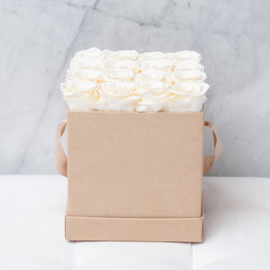 Sixteen Champagne Roses in Nude Suede Box
