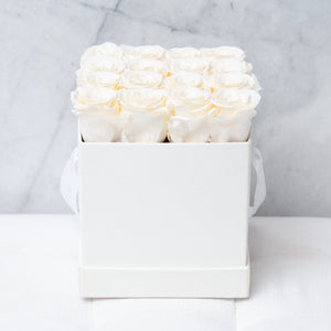 Sixteen Champagne Roses in White Suede Box