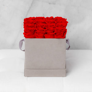 Sixteen Red Roses in Light Gray Suede Box