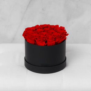 Small Round Red Roses in Black Suede Box