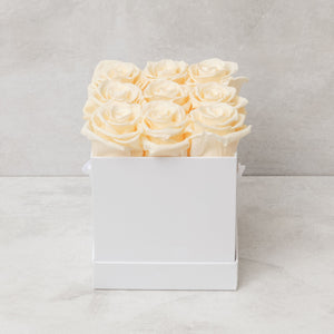 Nine Champagne Roses in White Box