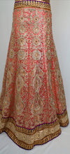 Peach and gold contrast lehenga with green dupatta