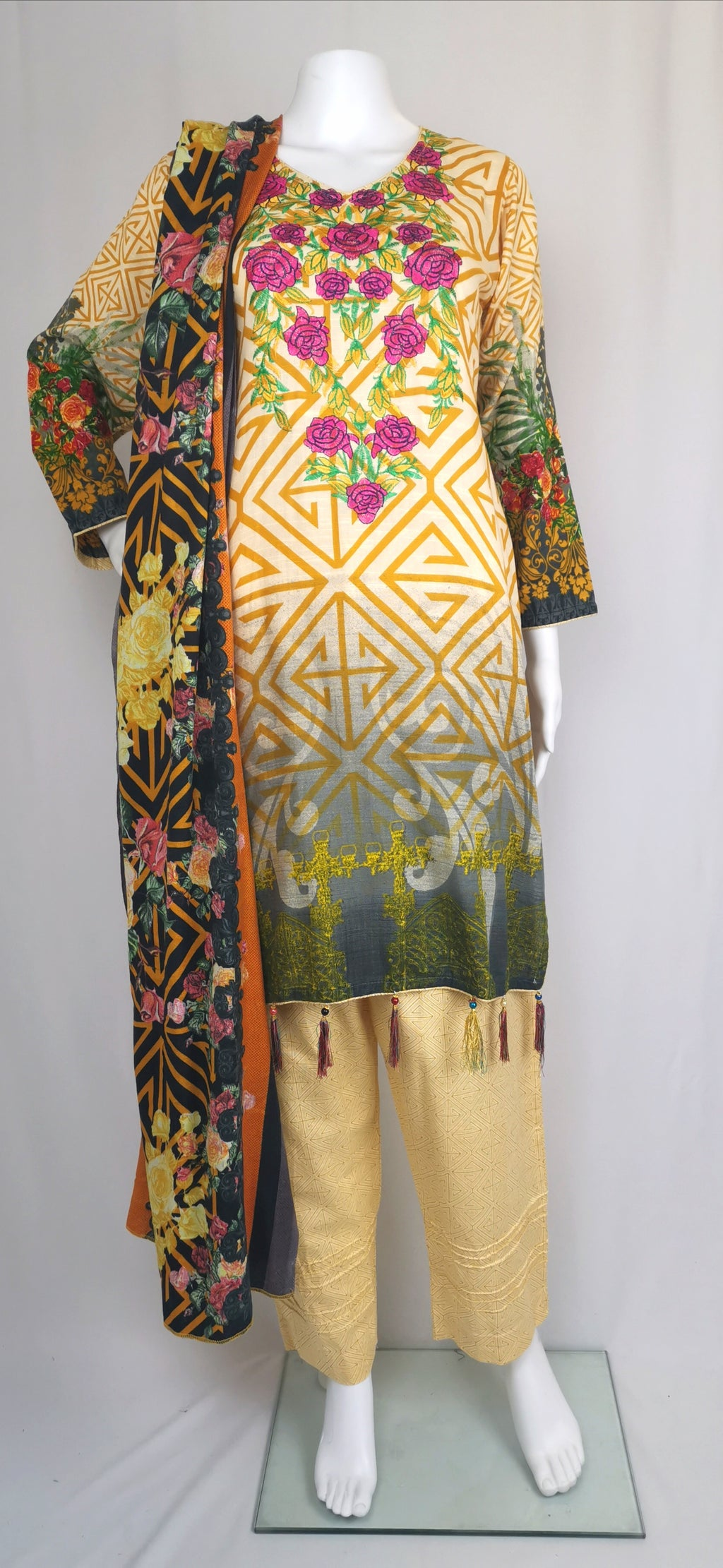 pale yellow printed trouser suit with embroidered neck line