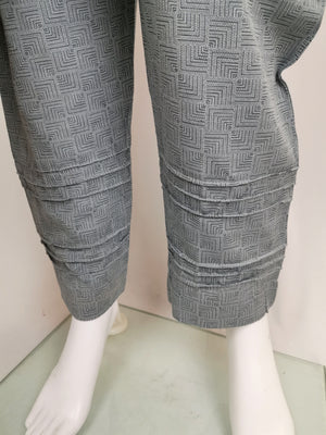 Grey trouser suit with embroidered neck