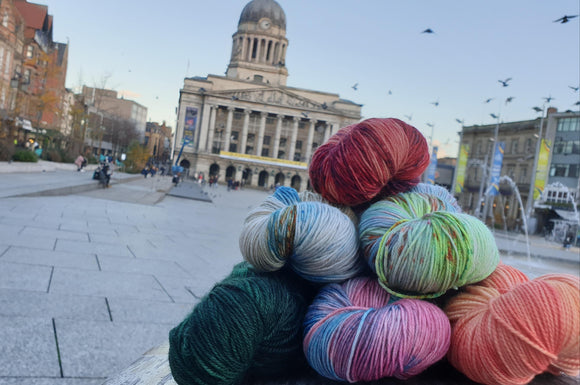 A neat pile of yarn with the Council House, Nottingham in the background