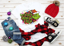 Load image into Gallery viewer, Resting Grinch Face Buffalo Plaid Background, Grinch Christmas Shirt, Funny Christmas Shirt, Choose Shirt Color - The Hot Polka Dot