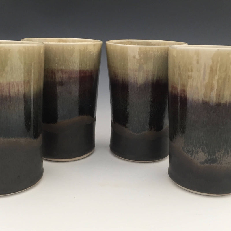 Set of 4 tumblers in matte black and honey luster