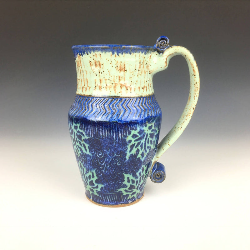 Bright and whimsical ceramic cup