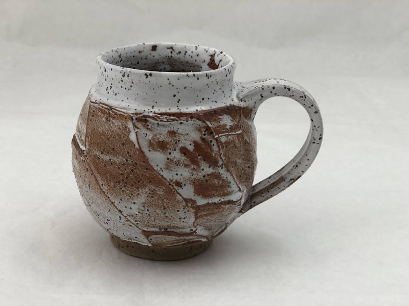 Twisty white rimmed mug