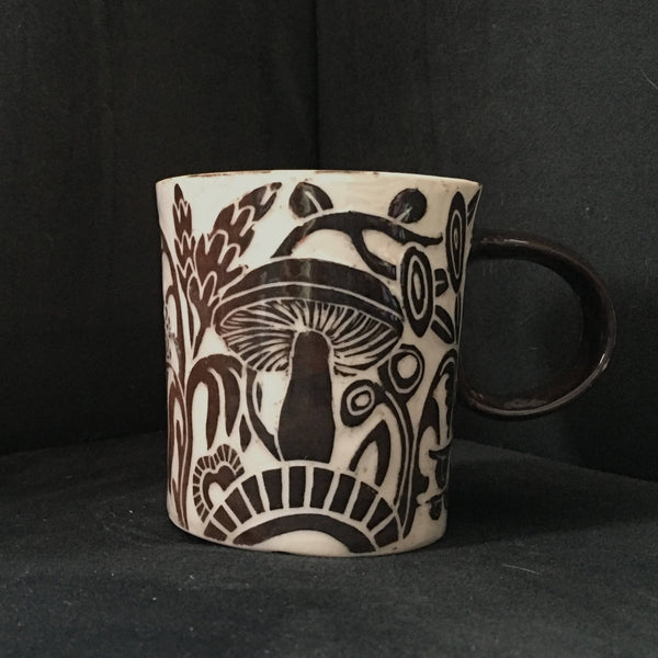 small porcelain mug in blackish brown