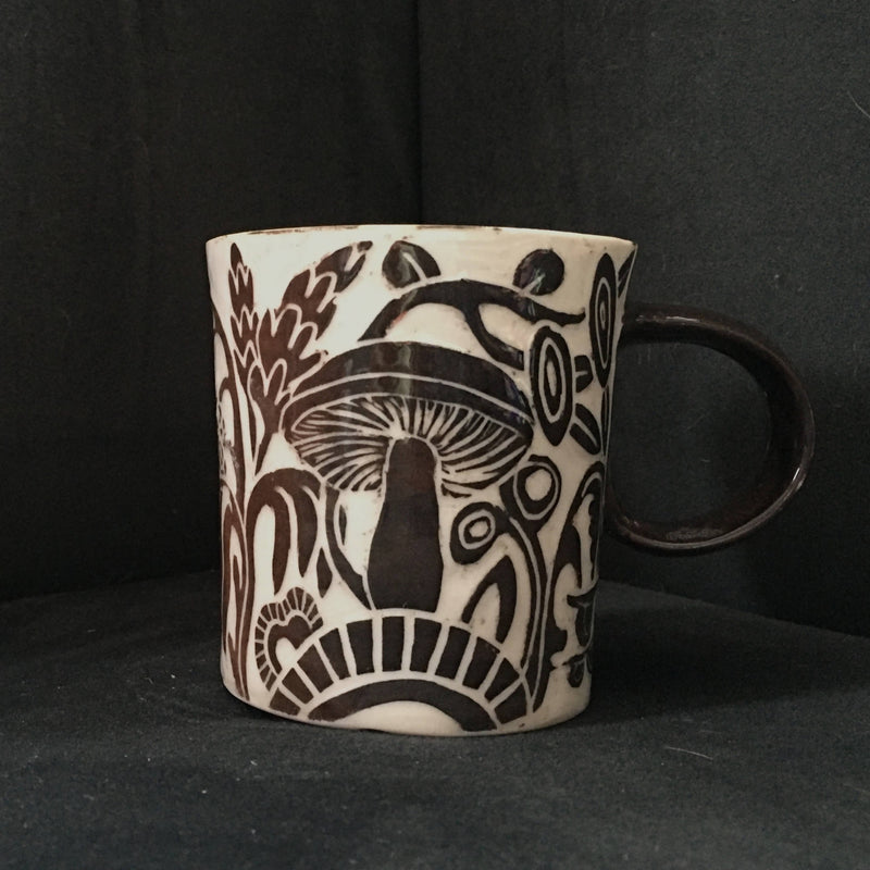 small blackish brown carved porcelain mug