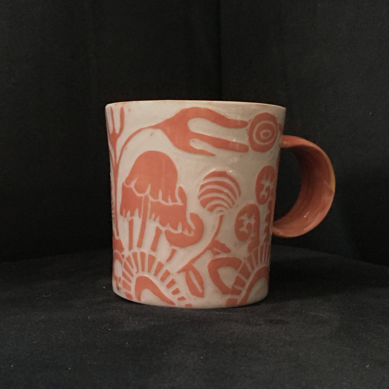small tangerine carved porcelain mug