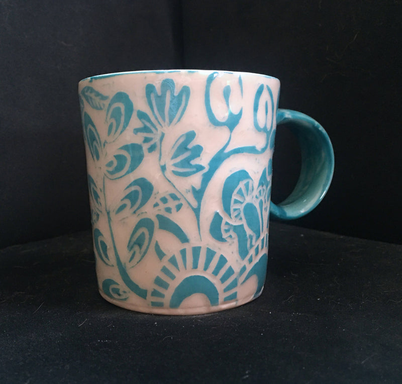 small turquoise carved porcelain mug