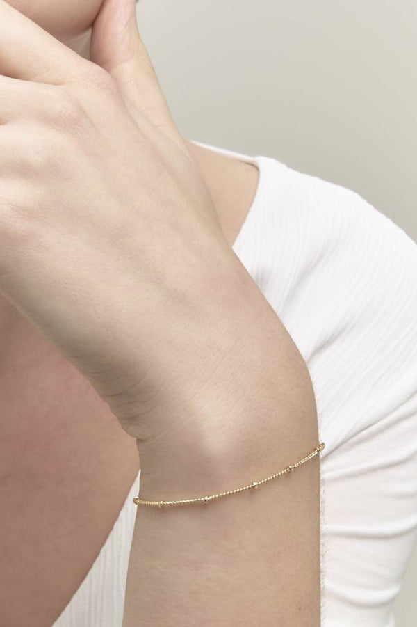 gold plated armbandje riverstones
