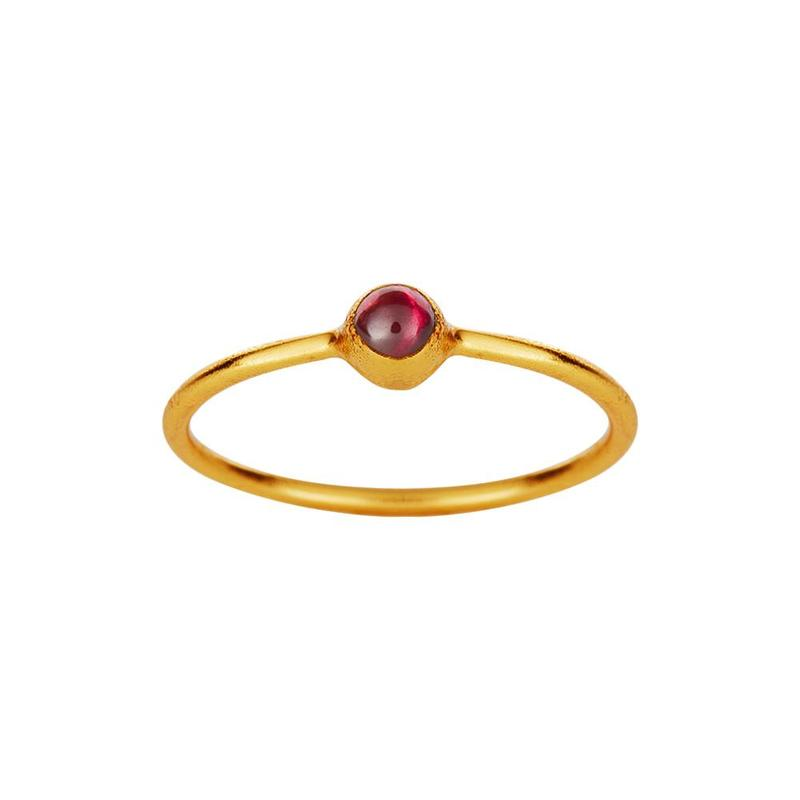 Gold plated ring with small red garnet