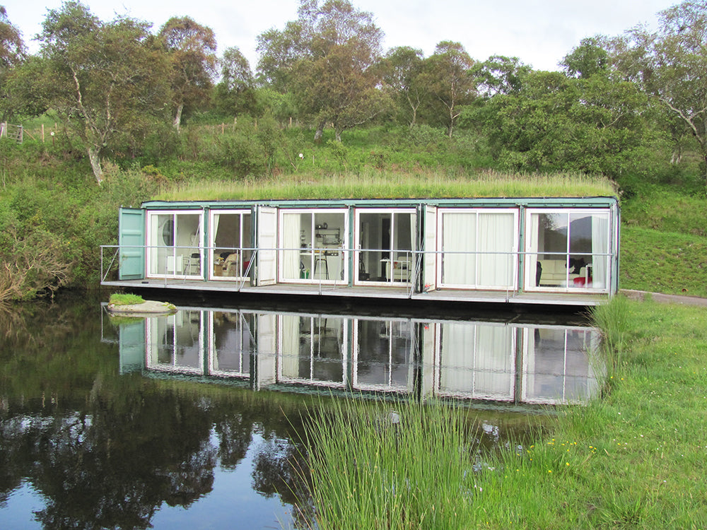 Accommodation at Cove Park - A set of modified shipping containers with a grass roof