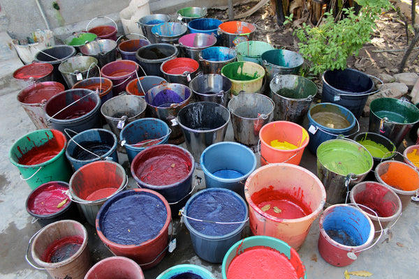 Buckets of ink at the block printing workshop, Ahmedabad.