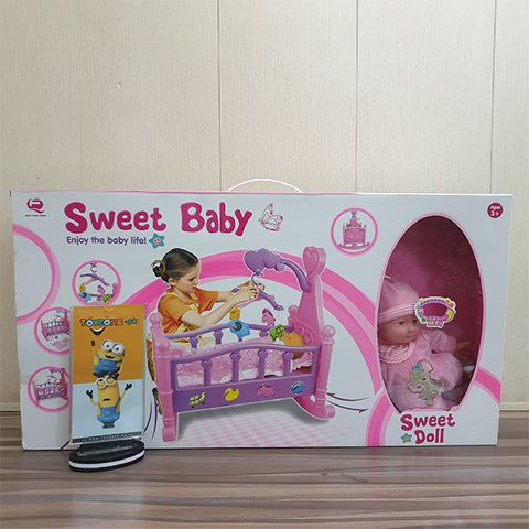 Image of Rocking Bed With Doll