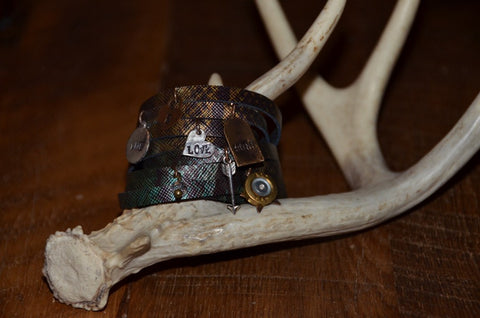 Handmade camo pattern green/brown/shimmer slit leather wraparound bracelet with Live Love Hunt tags and multiple charms
