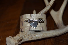 Handmade shimmery cream croc print leather cuff with rhinestone arrow and CRUSH heart dangle tag